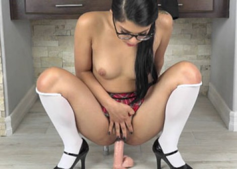 Latina coed Gina bounces on a dildo